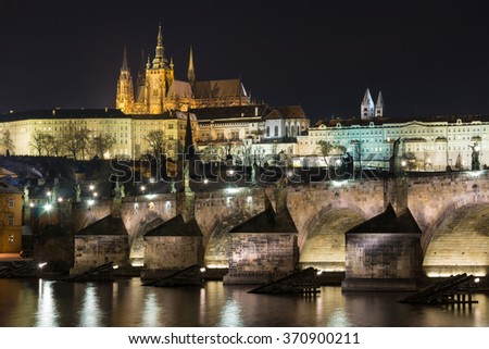 Prague Castle and Charles Bridge in the night. - stock photo