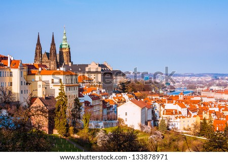 Prague castle and Lesser Town red roofs scenery - stock photo