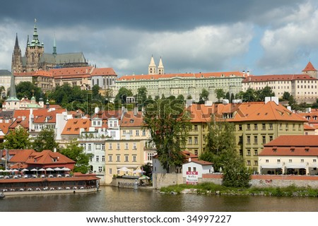 Prague castle and storm approaching - stock photo