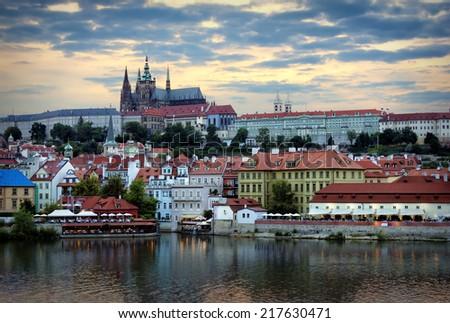 Prague Castle and the embankment of Vltava River by summer evening, Prague - stock photo