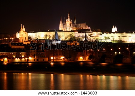 Prague Castle at night over danube river