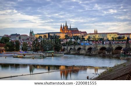 Prague Castle, Charles Bridge and the embankment of Vltava River by summer evening, Prague - stock photo