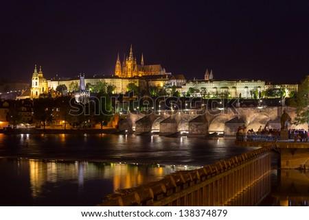 Prague castle, Charles Bridge and Vltava river at night, Czech Republic - stock photo