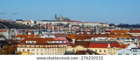 prague castle viewed from vysehrad castle complex is the highlight of panorama or prague which is also remarkable for typical red rooftops. - stock photo