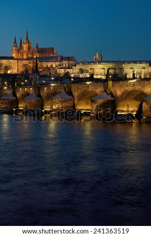Prague Castle with Charles Bridge in the winter evening, Czech Republic
