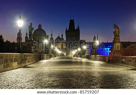 Prague Charles bridge at dawn - stock photo