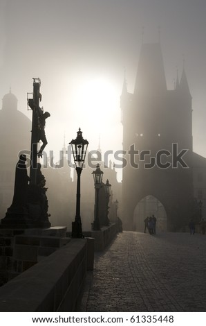 Prague - Charles bridge in the morning fog - stock photo