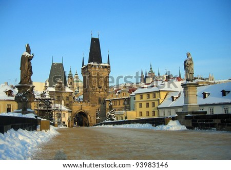 Prague Charles Bridge in winter with snow - stock photo