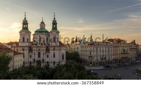 Prague Cityscape, St. Nicholas Church (Mala Strana) Aerial View from Astronomical Clock Tower, Prague Old Town Skyline under Golden Sky at Sunset Summer. Baroque church in Old Town, Czech Republic - stock photo