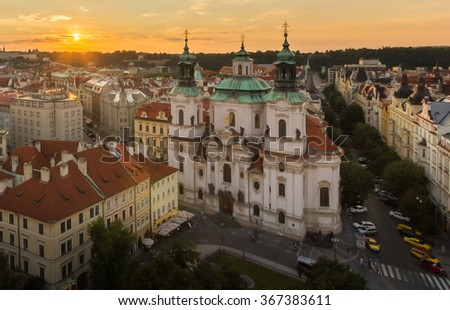 Prague Cityscape, St. Nicholas Church (Mala Strana) Aerial View from Astronomical Clock Tower, Prague Castle, Old Town Skyline under Golden Sky at Sunset Summer. Baroque church, Czech Republic - stock photo