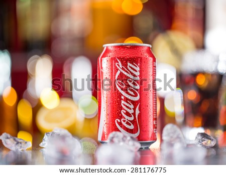 PRAGUE, CZ - APRIL 6, 2015: Can of Coca-Cola on bar desk, close-up. Coca-Cola Company is the leading manufacturer of soda drinks in the world.  - stock photo