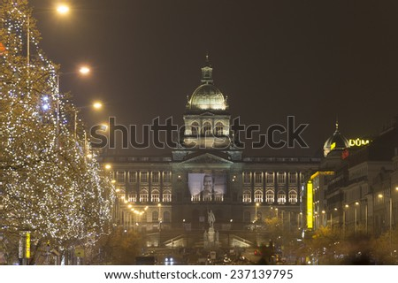PRAGUE, CZ - NOVEMBER 29: Wenceslas square at night with national museum at the top is always admired by tourists during winter. Every year there are markets and decorations, Prague, November 29, 2014 - stock photo