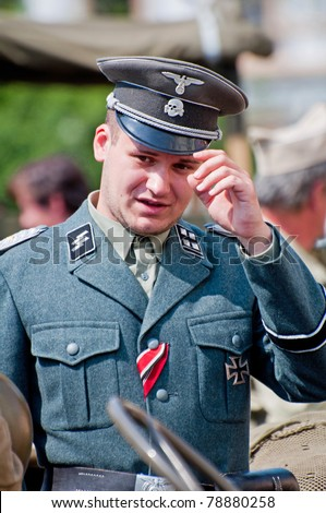 PRAGUE, CZECH REP. - APR 29:Unidentified member of Old Car Rangers club wears historic German uniform April 29, 2011, Prague. It´s part of reenactment event - fall of German army in Prague during WWII