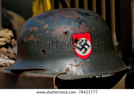 PRAGUE, CZECH REP. - 29 APRIL: Nazi helmet on American historical Jeep of Old Car Rangers club on April 29, 2011. It is part of reenactment event - the fall of German army in Prague in 1945. - stock photo