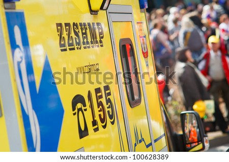PRAGUE, CZECH REPUBLIC - APRIL 24: Ambulance trying to pass the crowd during protest event Stop Vlade at Wenceslaw square, Prague, on April 24, 2012