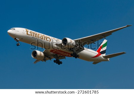 PRAGUE, CZECH REPUBLIC - APRIL 10: Boeing 777-300ER Emirates lands to PRG Airport on April 10, 2015. Emirates is an airline based in Dubai. - stock photo