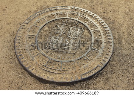 PRAGUE, CZECH REPUBLIC - APRIL 21, 2016: Greater coat of arms of the Czech Republic displayed on a manhole cover in the garden of the Wallenstein Palace in Prague, Czech Republic.