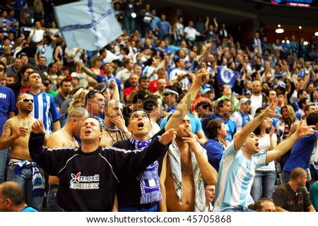 PRAGUE, CZECH REPUBLIC - APRIL 5: Iraklis team supporters watch the volleyball game of Final Four CEV Indesit Champions League at O2 Arena April 5, 2009 in Prague. - stock photo