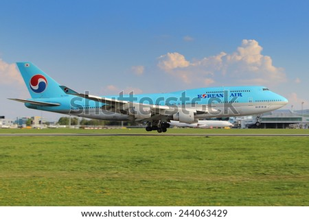 PRAGUE, CZECH REPUBLIC - APRIL 23: Korean Air Boeing 747-4B5 lands at PRG Airport on April 23, 2014. Korean air is the flag carrier airline of South Korea - stock photo