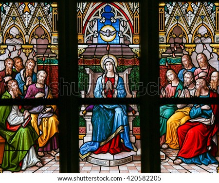 PRAGUE, CZECH REPUBLIC - APRIL 5, 2016: Stained Glass in the Basilica of Vysehrad in Prague, Czech Republic, depicting the Descent of the Holy Spirit at Pentecost - stock photo