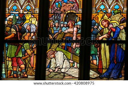 PRAGUE, CZECH REPUBLIC - APRIL 5, 2016: Stained Glass in the Basilica of Vysehrad in Prague, Czech Republic, depicting Jesus Christ falling under the cross on the Via Dolorosa - stock photo