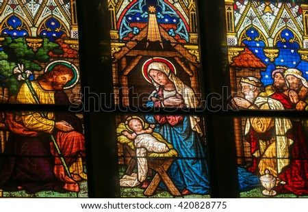 PRAGUE, CZECH REPUBLIC - APRIL 5, 2016: Stained Glass in the Basilica of Vysehrad in Prague, Czech Republic, depicting the visit of the Three Kings to the Infant Jesus - stock photo