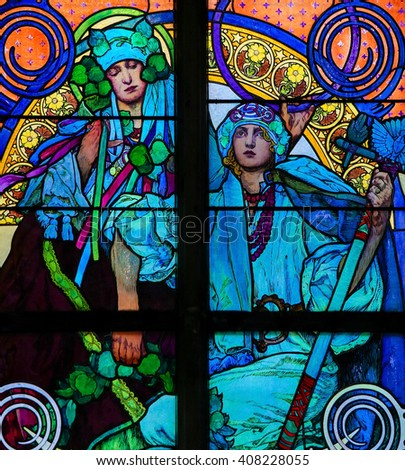 PRAGUE, CZECH REPUBLIC - APRIL 2, 2016: Stained Glass window in St. Vitus Cathedral, Prague, designed by Alphonse Mucha. - stock photo