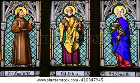 PRAGUE, CZECH REPUBLIC - APRIL 2, 2016: Stained Glass window in St. Vitus Cathedral, Prague, depicting Saint Francis, Saint Peter and Saint Elisabeth - stock photo