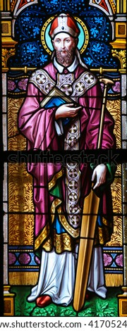 PRAGUE, CZECH REPUBLIC - APRIL 2, 2016: Stained Glass window in St. Vitus Cathedral, Prague, depicting St. Adalbert of Prague (956 â?? 997), a Bohemian missionary and Christian saint.
