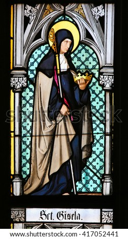 PRAGUE, CZECH REPUBLIC - APRIL 2, 2016: Stained Glass window in St. Vitus Cathedral, Prague, depicting Blessed Gisela of Hungary (985-1065), spouse of Saint Stephen of Hungary. - stock photo