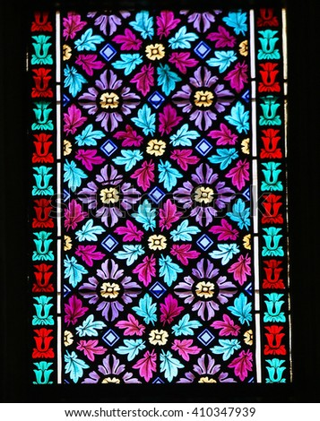 PRAGUE, CZECH REPUBLIC - APRIL 2, 2016: Stained Glass window in St. Vitus Cathedral, Prague, a symmetrical pattern of flowers and leaves. - stock photo