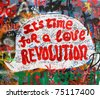 PRAGUE, CZECH REPUBLIC - APRIL 12:The Lennon Wall since the 1980s filled with John Lennon-inspired graffiti and pieces of lyrics from Beatles songs on Apr 12, 2011 in Prague, Czech Republic - stock photo
