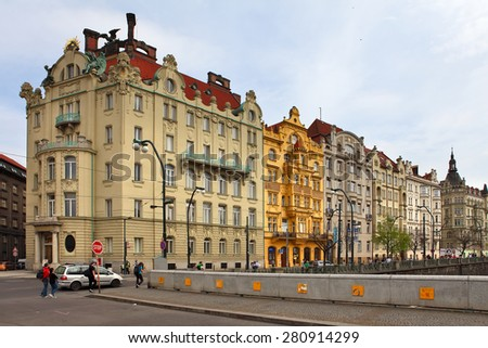 Prague, Czech Republic - April 25, 2015: Typical old street with traditional Czech beautiful facades of old houses. - stock photo