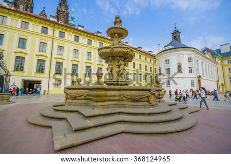 Prague, Czech Republic - 13 August, 2015: Beautiful water fountain located on city square with towers from St. Vitus in background