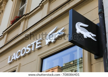 Prague, Czech Republic - August 27, 2017: Lacoste sign on a store. Lacoste is a French clothing company that sells high-end clothing, footwear, perfume, leather goods, and most famously polo shirts