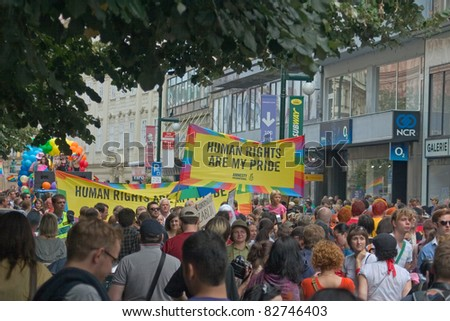 PRAGUE, CZECH REPUBLIC - AUGUST 13: Participants and spectators in the first Prague Pride Parade, a festival of tolerance, on August 13, 2011 in Prague, Czech Republic