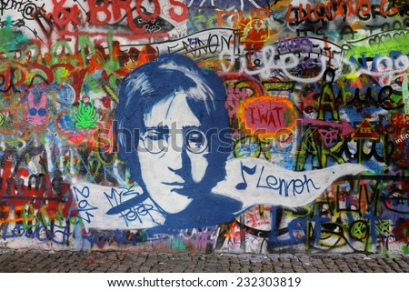 PRAGUE, CZECH REPUBLIC - AUGUST 19: The Lennon Wall since the 1980s is filled with John Lennon-inspired graffiti and pieces of lyrics from Beatles songs on august 19, 2014 in Prague, Czech Republic - stock photo
