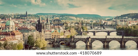 Prague, Czech Republic bridges skyline with historic Charles Bridge and Vltava river in the afternoon. Vintage - stock photo