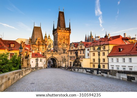 Prague, Czech Republic. Charles Bridge with its statuette, Lesser Town Bridge Tower and the tower of the Judith Bridge. - stock photo