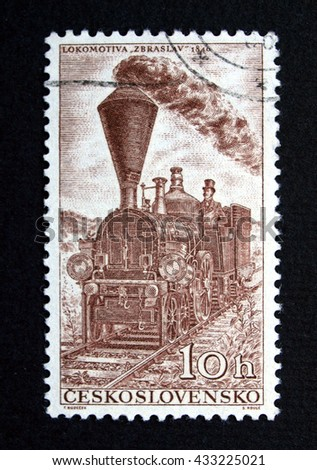 PRAGUE, CZECH REPUBLIC - CIRCA JULY 2009: Stamp of former Czechoslovakia with steam engine locomotive - stock photo