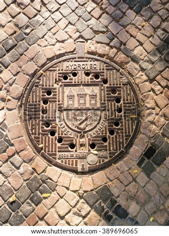 PRAGUE, CZECH REPUBLIC - CIRCA JULY, 2015:Traditional manhole cover for street hatchway in Prague, Czech republic - stock photo