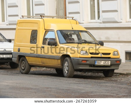 PRAGUE, CZECH REPUBLIC - CIRCA MARCH 2015: Yellow Renault Express Van parked in a street of the city centre.  - stock photo