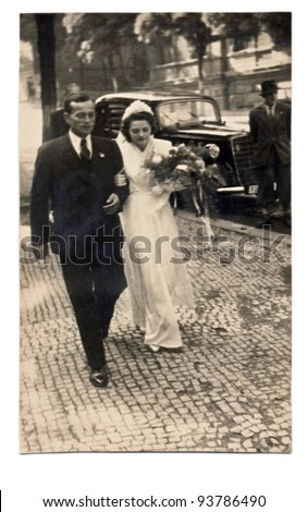 PRAGUE , CZECH REPUBLIC , CIRCA 1945 - married couple on Wenceslas Square - stock photo