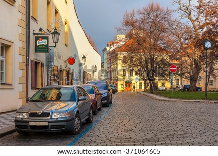 PRAGUE, CZECH REPUBLIC - DECEMBER 10, 2015: Cobblestone street in old town of Prague -  popular tourist destination, capital and largest city of Czech Republic and fifth most visited European city. - stock photo