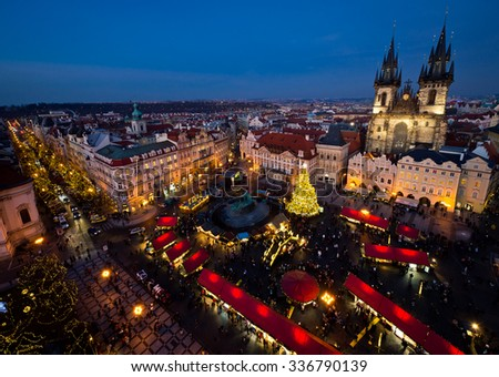 PRAGUE, CZECH REPUBLIC - DECEMBER 17, 2013: Old Town Square in Prague, Czech republic, during Christmas season on Dec 17, 2013 in Prague. Every year the Christmas market begins at the end of November - stock photo