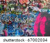 PRAGUE, CZECH REPUBLIC - DECEMBER 11:The Lennon Wall since the 1980s filled with John Lennon-inspired graffiti and pieces of lyrics from Beatles songs on Dec 11, 2010 in Prague, Czech Republic - stock photo