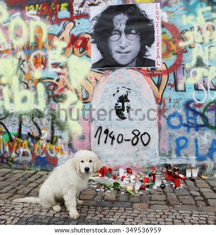 PRAGUE, CZECH REPUBLIC - DECEMBER 10: The Lennon Wall since the 1980s is filled with John Lennon-inspired graffiti and pieces of lyrics from Beatles songs on Dec 10, 2015 in Prague, Czech Republic - stock photo