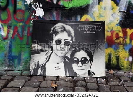 PRAGUE, CZECH REPUBLIC - DECEMBER 15: The Lennon Wall since the 1980s is filled with John Lennon-inspired graffiti and pieces of lyrics from Beatles. - stock photo