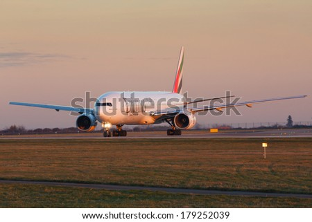 PRAGUE, CZECH REPUBLIC - JANUARY 07: Boeing 777-300 Emirates taxis for take offl in PRG Airport on January 07, 2014. Emirates is an airline based in Dubai. - stock photo