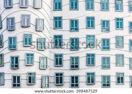 Prague, Czech Republic - 3 January 2014: Detailed view of the windows on Nationale-Nederlanden building, also known as The Dancing House, or Fred and Ginger, in Prague, Czech Republic.  - stock photo